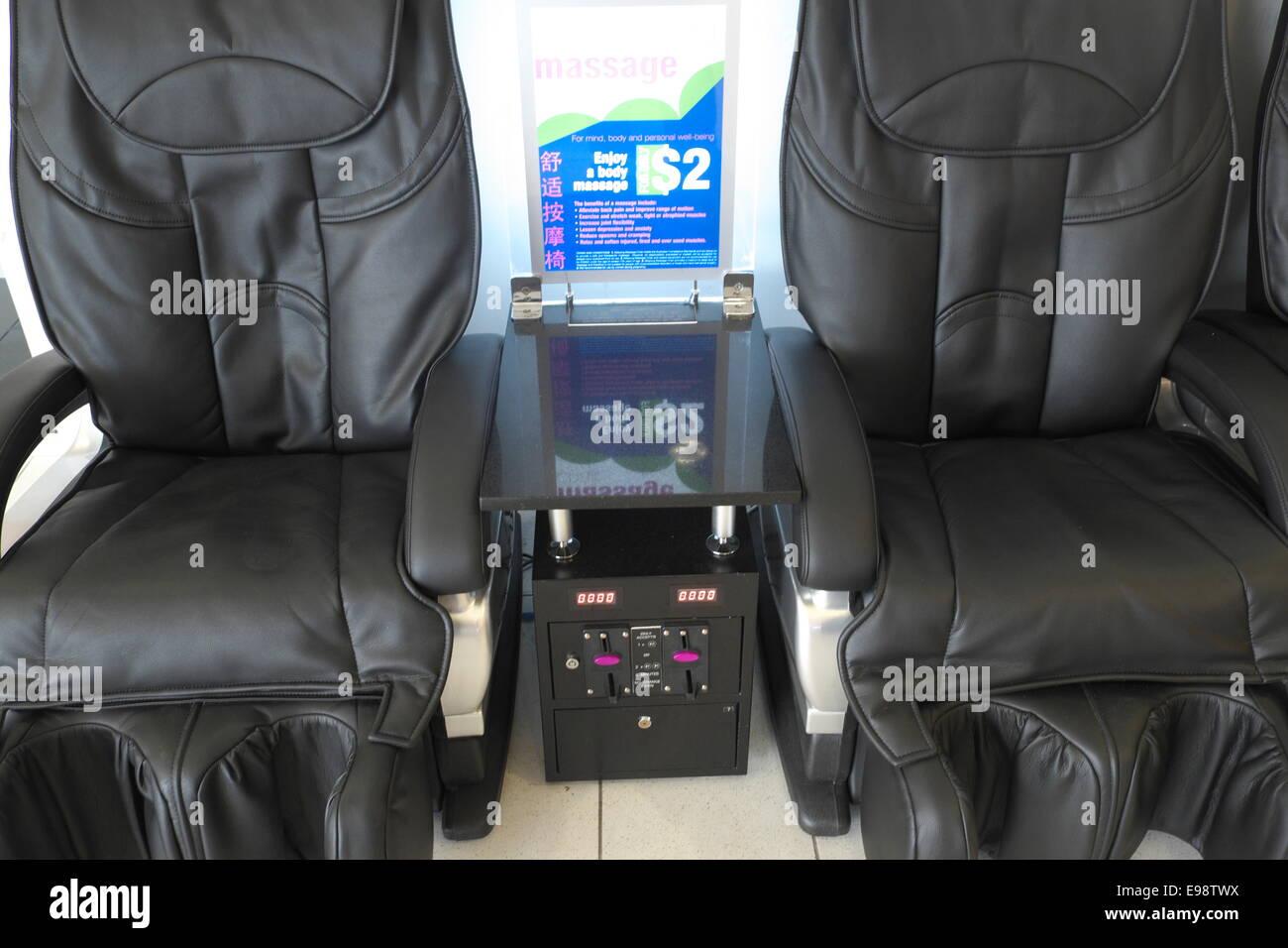 backache massage chairs at sydney airport,australia Stock Photo