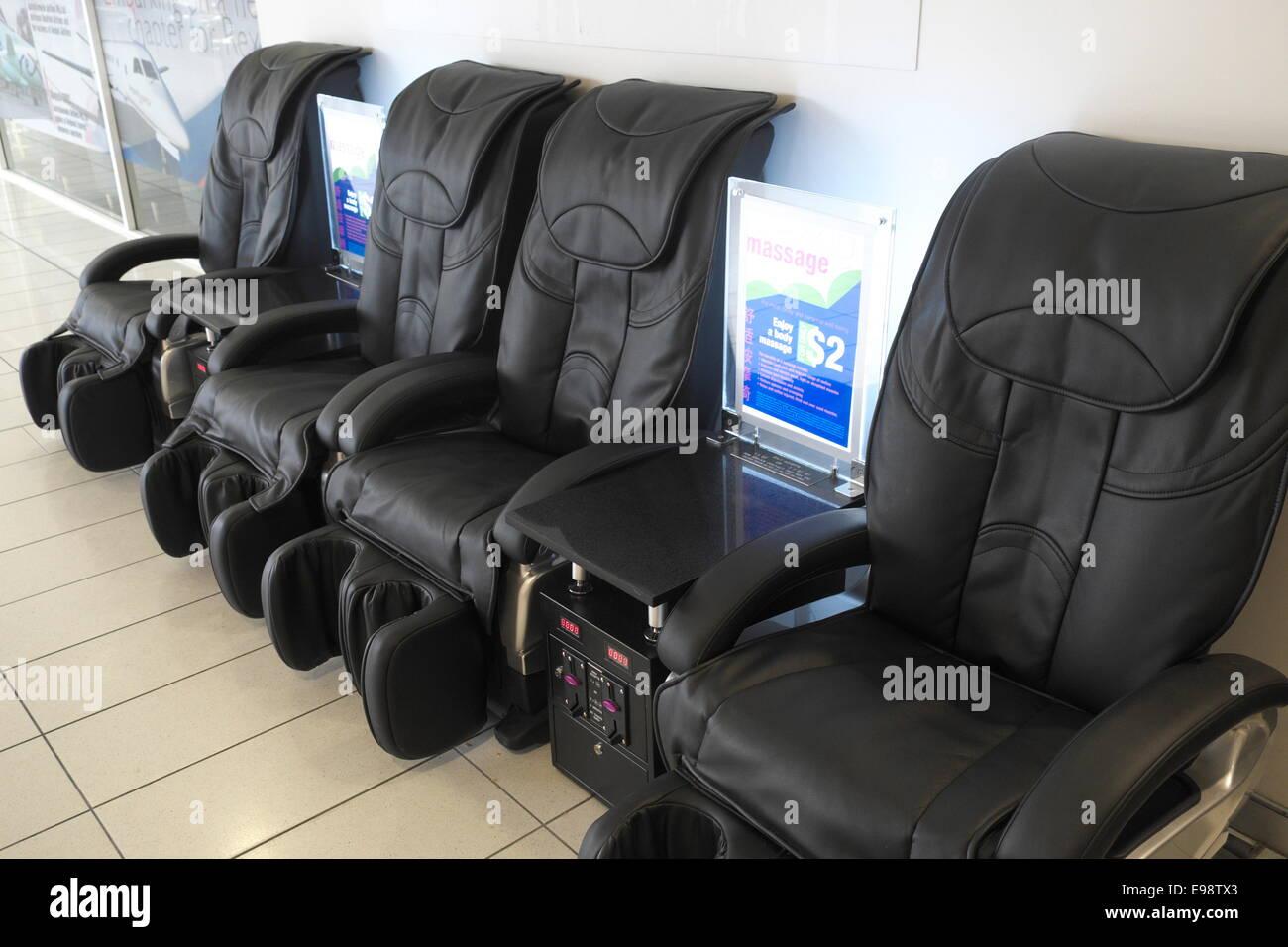 backache massage chairs at sydney airport australia stock photo