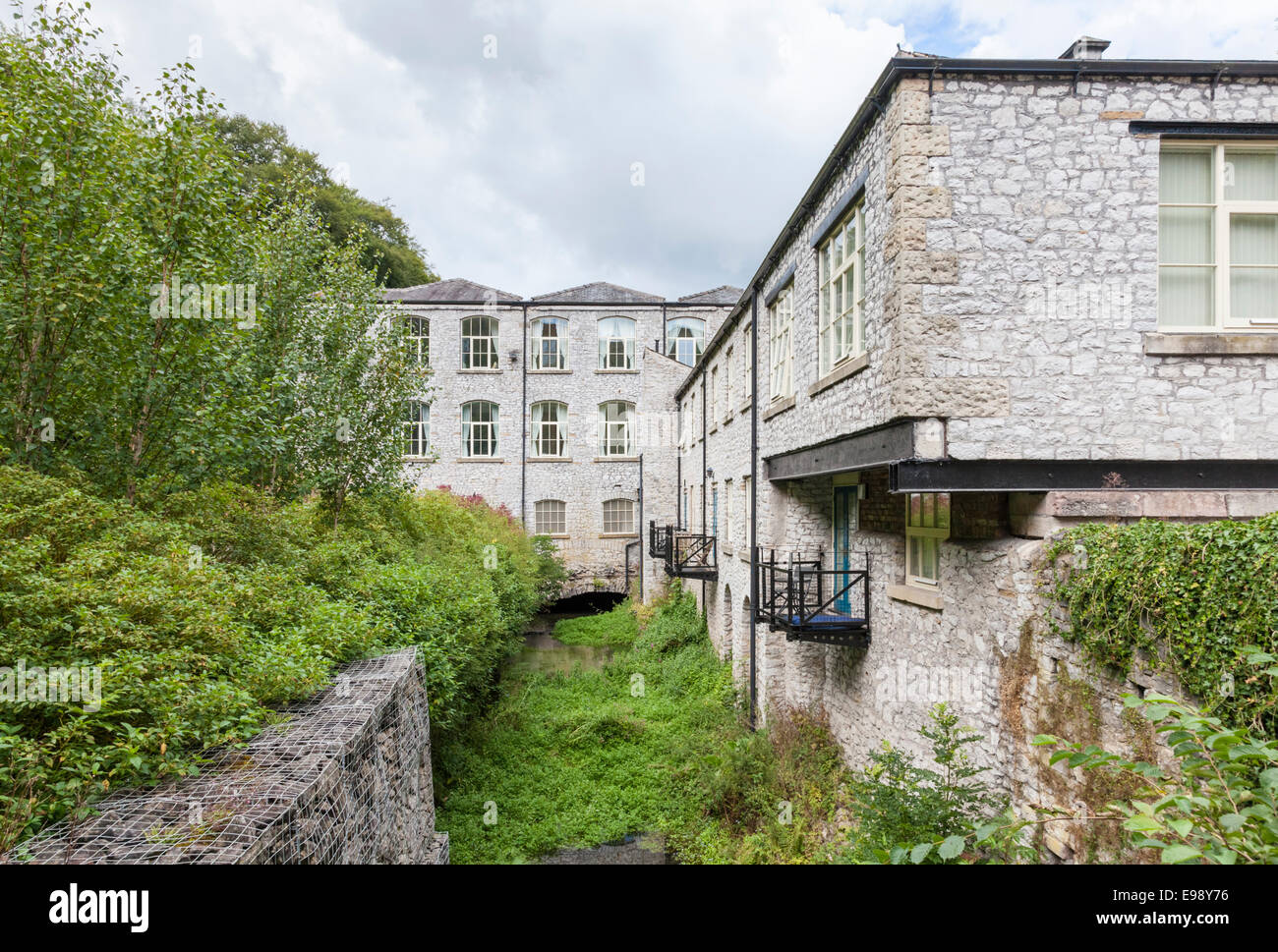 Building conversion. Litton Mill, now converted to a block of apartments, Derbyshire, England, UK - Stock Image