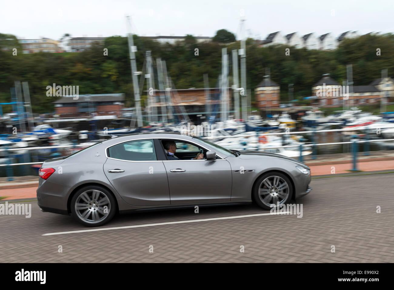 A Maserati Ghibli sports saloon car photographed at Penarth Marina, South Wales. Stock Photo