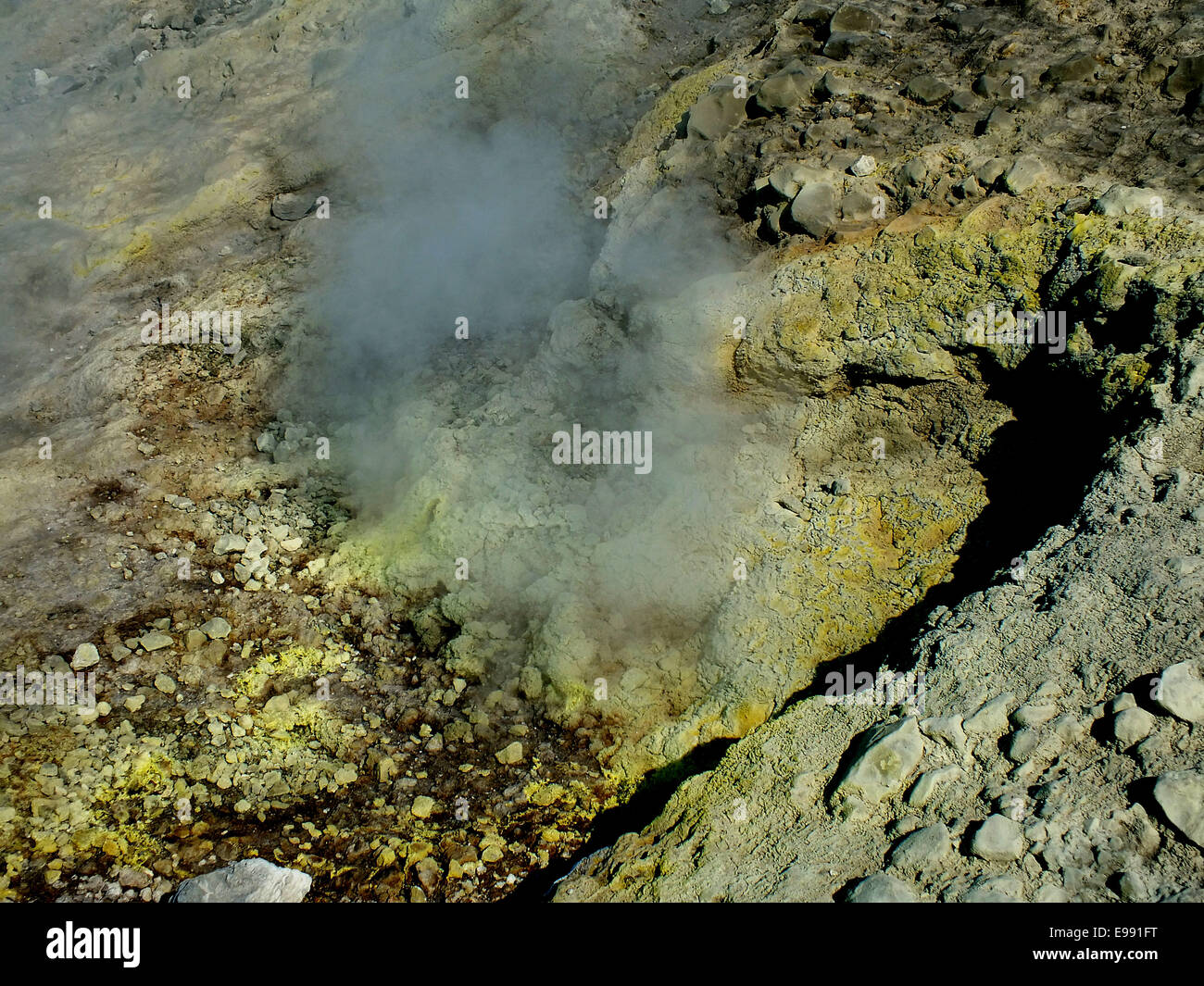 In the magma chamber penetrated seawater mixed with sulfur increases as poisonous gas (H2SO4) upwards and condenses - Stock Image