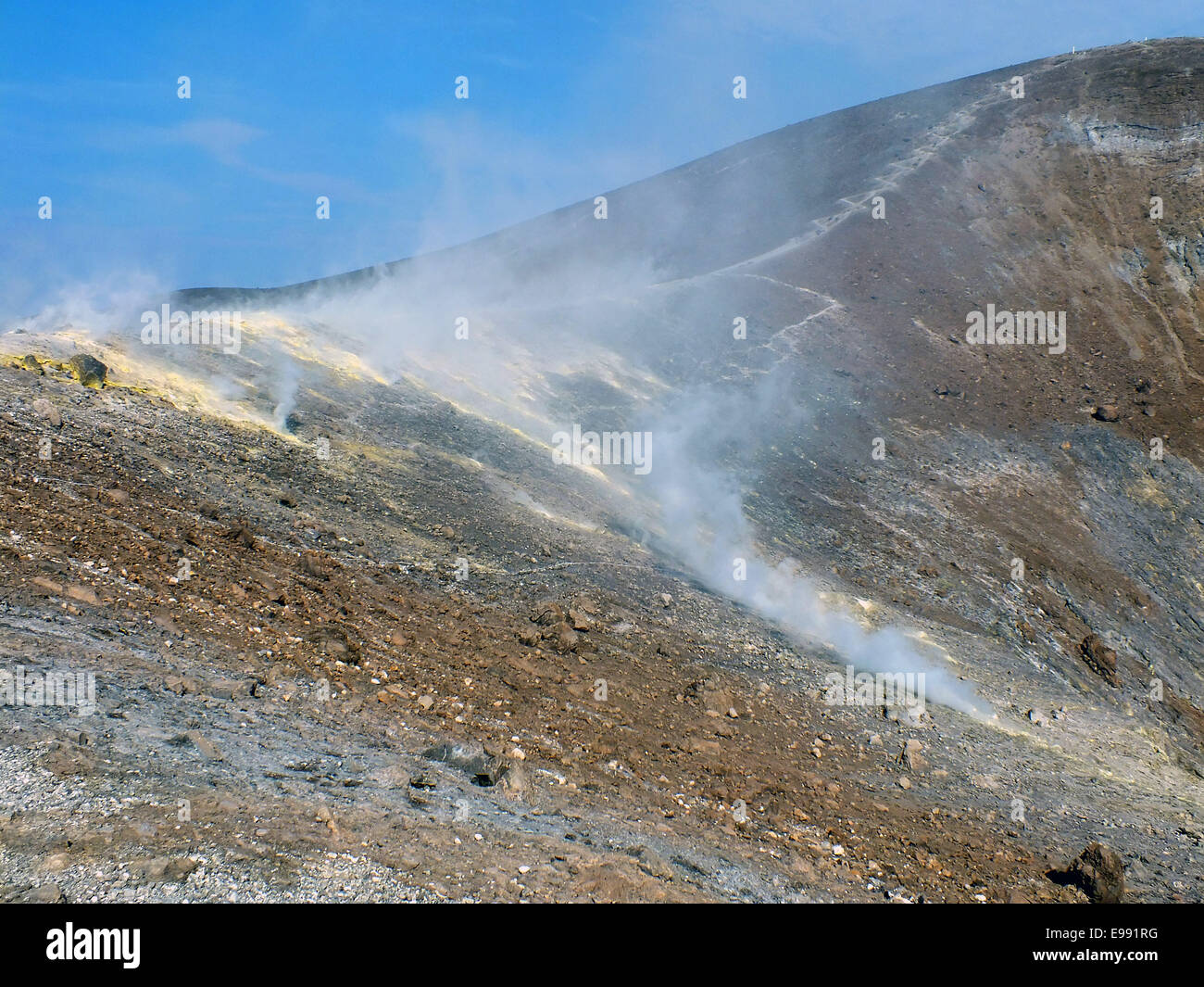 The path to the summit of Gran craters performs sulfur gas fields and toxic gas clouds - June 2014 - Stock Image