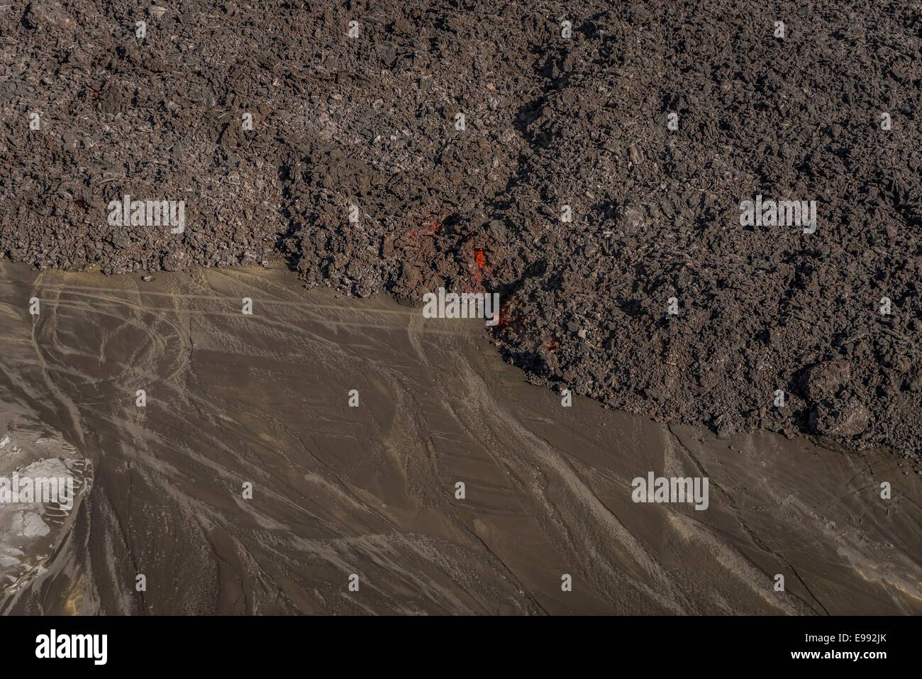 Lava flow with tire tracks, Holuhraun Fissure Eruption, near the Bardarbunga Volcano, Iceland. - Stock Image