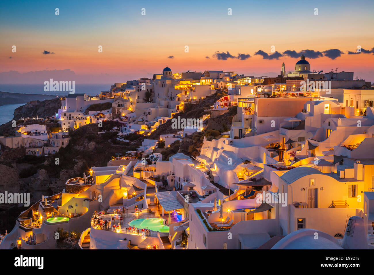 Pools And Hotels At Night In The Village Of Oia Santorini