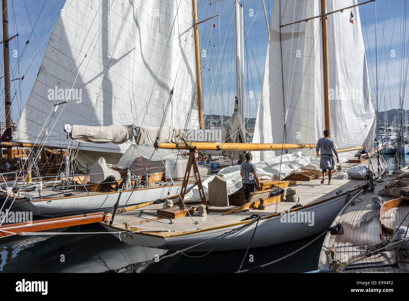 Yachtsmen on board of sailing boat in the harbour at Cannes, French Riviera, Côte d'Azur, Alpes-Maritimes, - Stock Image