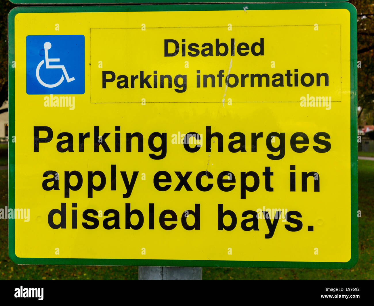 Sign reading Disabled Parking Information Parking Charges Apply except in disabled bays - Stock Image
