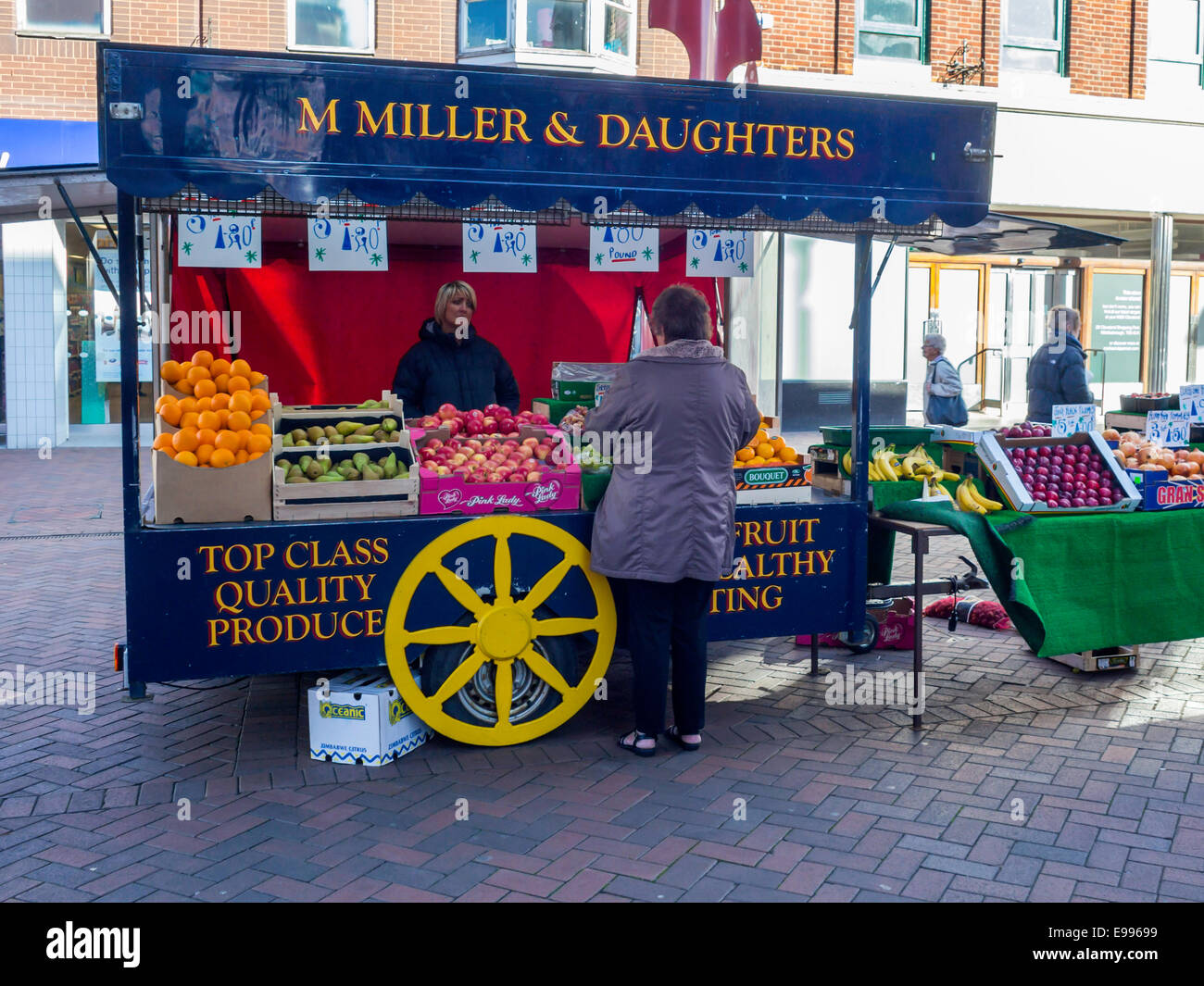 Market stall selling fruit with the slogan Fresh Fruit Healthy Eating - Stock Image