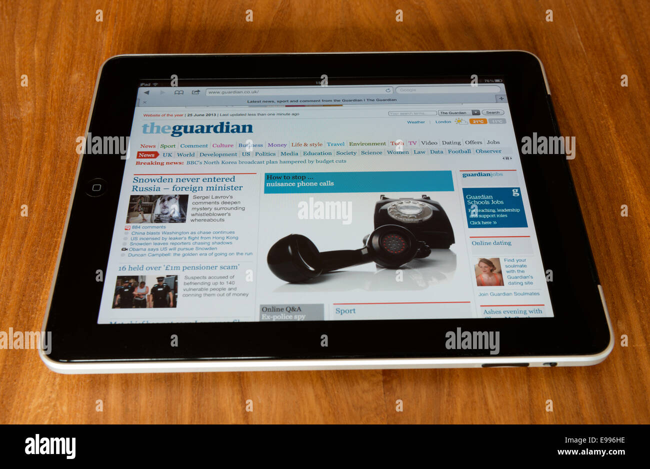 Apple iPad displaying the Guardian newspaper homepage with 'how to stop nuisance telephone calls' - Stock Image