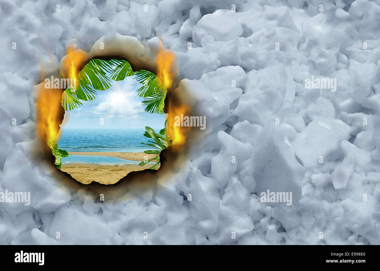 Winter escape concept as a burning hole on a cold winter snow background revealing a hot tropical beach and ocean - Stock Image