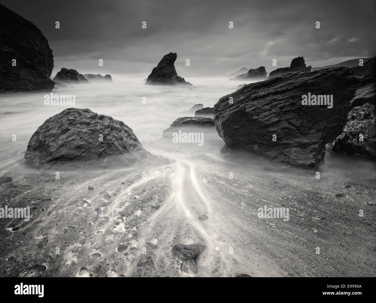 Beach in black and white. This beach is called Fontes beach and is located in Ferrol, Galicia, Spain. - Stock Image