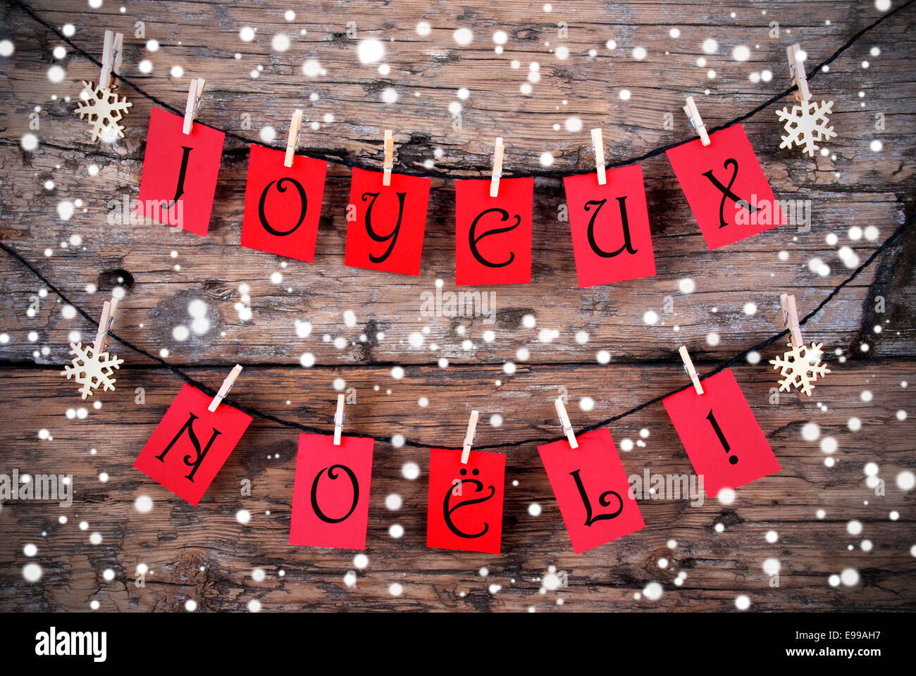 snowy christmas background with the french words joyeux. Black Bedroom Furniture Sets. Home Design Ideas