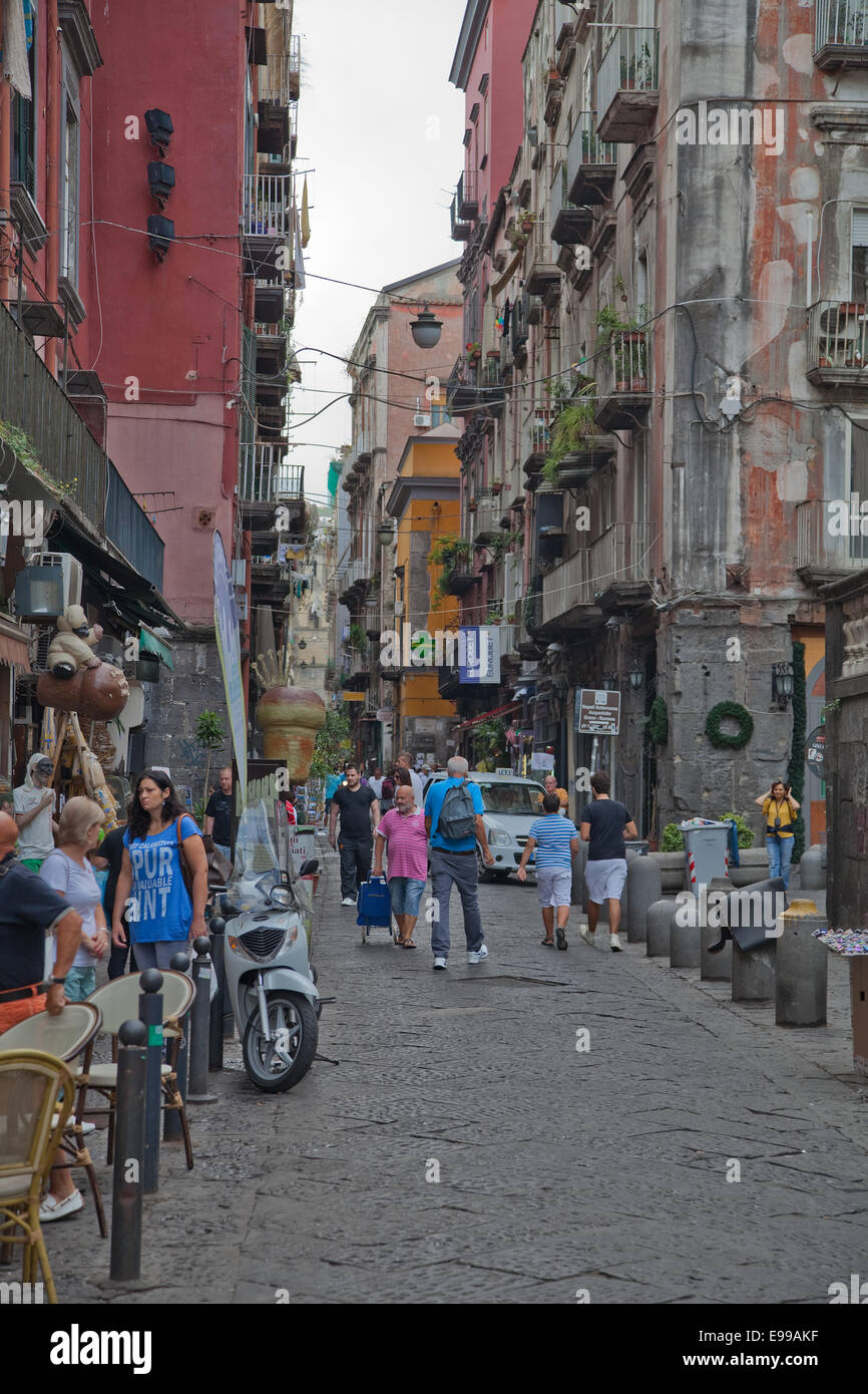 Naples,Italy side streets all over the city throng with gift shops,caffes, pizza restaurants,and churches. - Stock Image