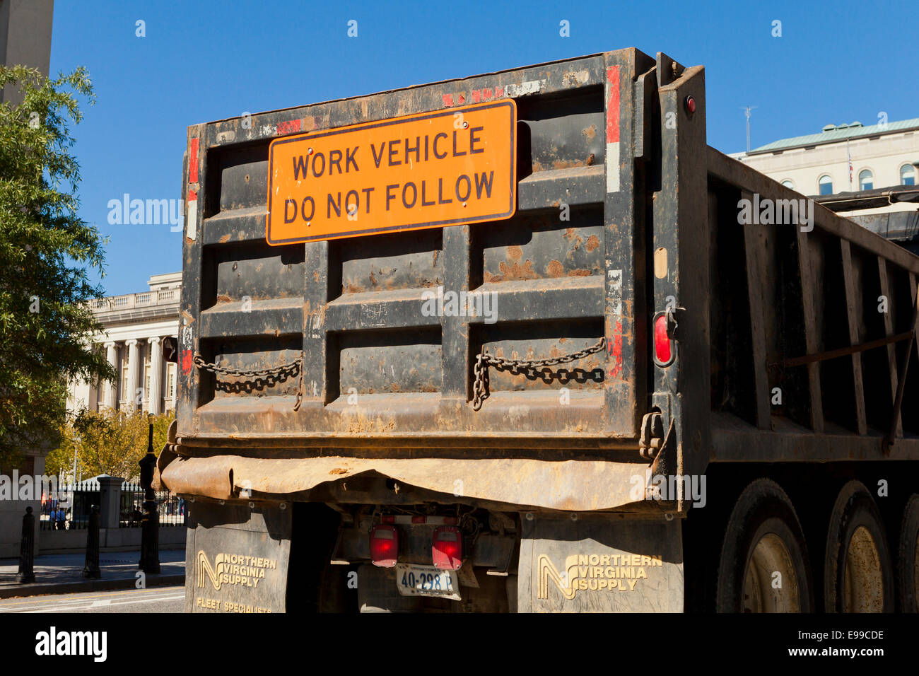 Do not follow warning message of construction work truck - USA - Stock Image