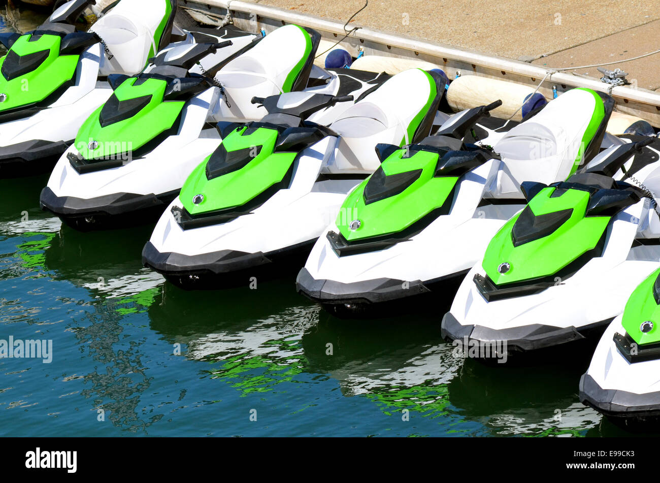 Line of personal watercraft. Concept photo extreme water sport and transportation - Stock Image
