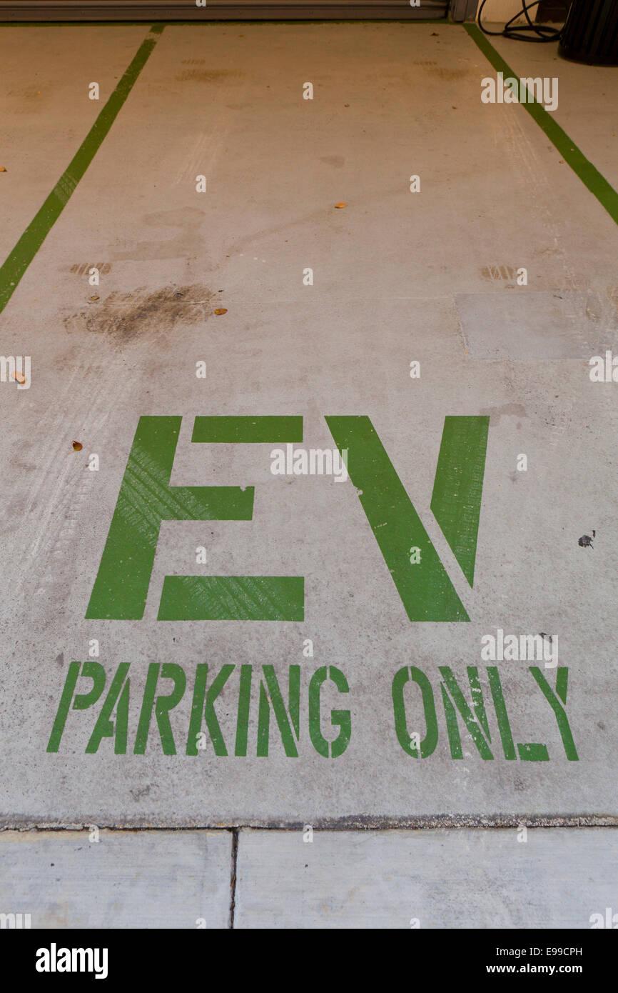 Electric Vehicle designated parking spot - USA - Stock Image
