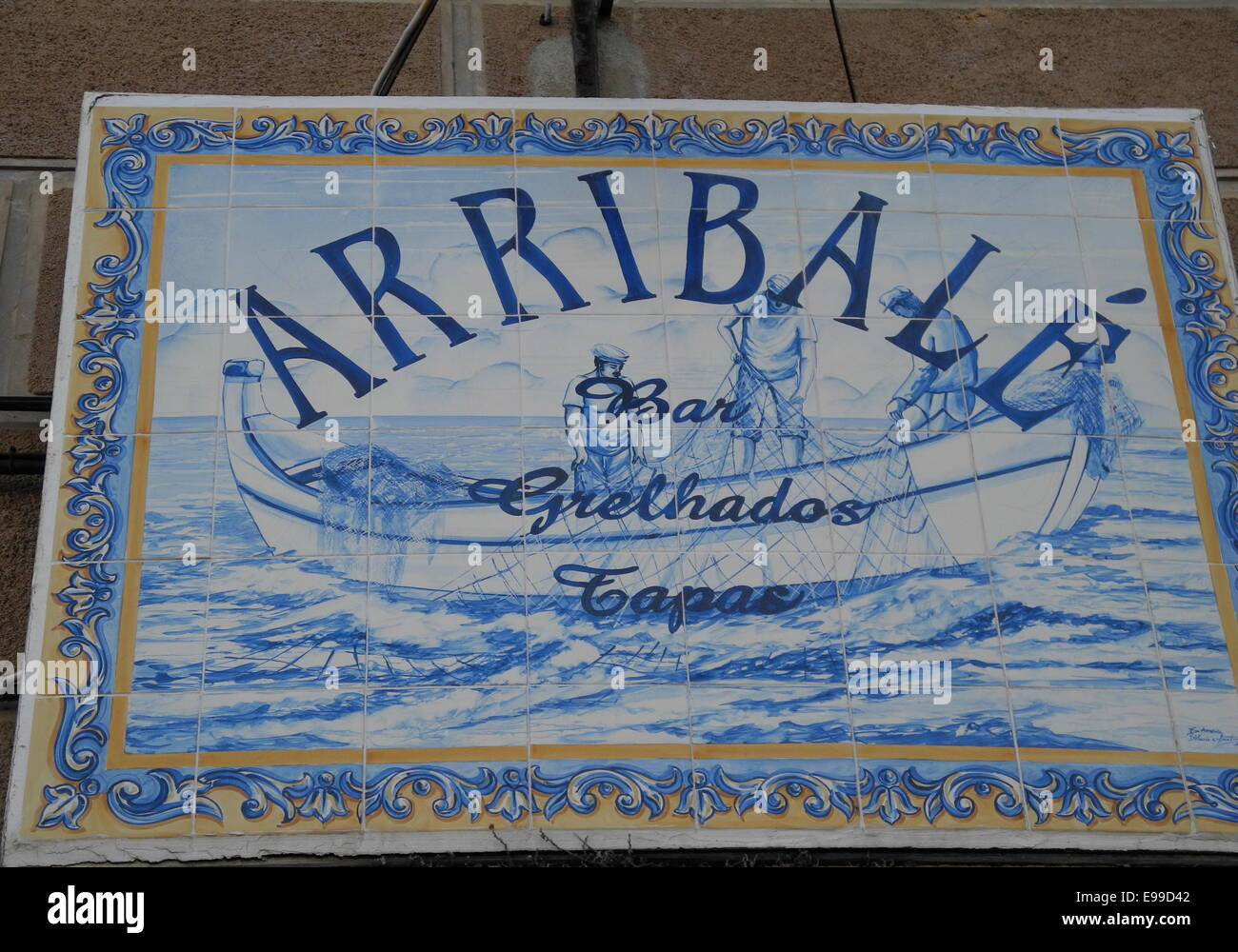 A Tile Restaurant Sign in Aveiro, Portugal In Portugal, many signs are made using the famous Portuguese azulejos - Stock Image