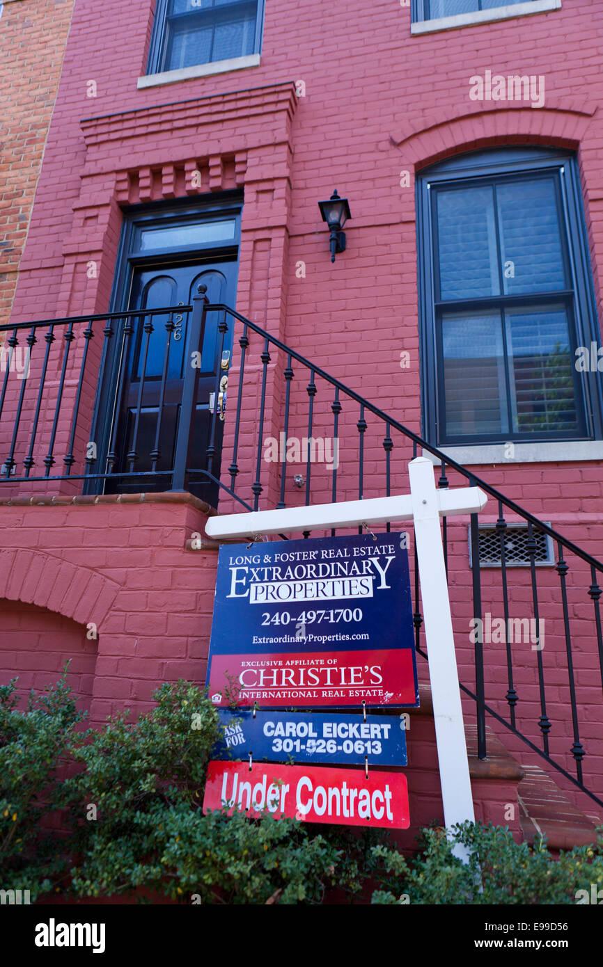 Long & Foster realtor sign on brick townhouse - Virginia USA - Stock Image