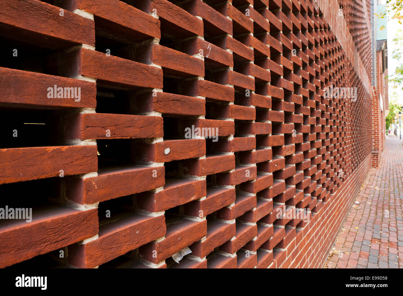 Perforated brickwork design (hit-and-miss) used on wall of building - Alexandria, Virginia USA - Stock Image