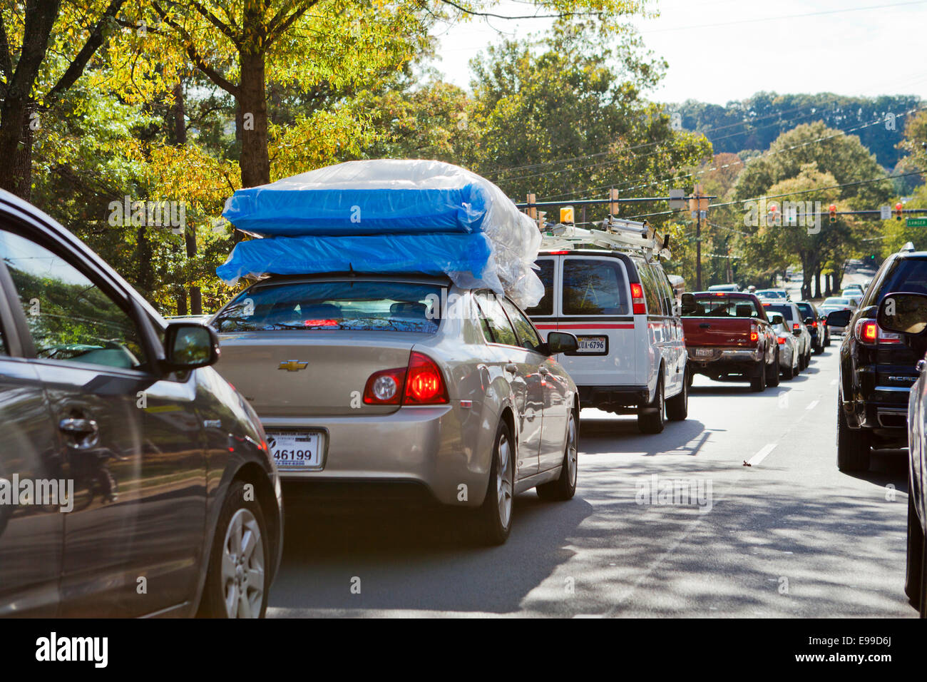 Car with mattresses on top - USA - Stock Image