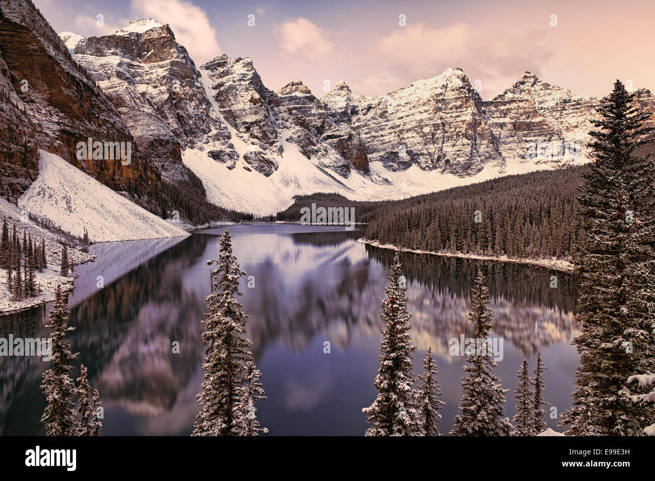 Autumn snowfall at Moraine Lake with the Valley of Ten Peaks in Alberta's Canadian Rockies and Banff National - Stock Image