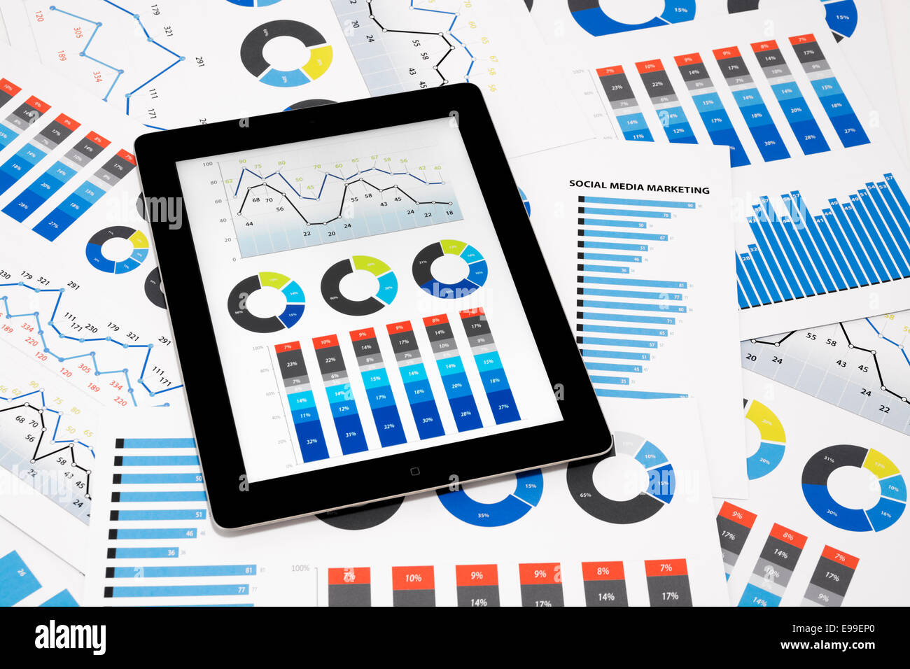 Business charts and diagrams on digital tablet. - Stock Image