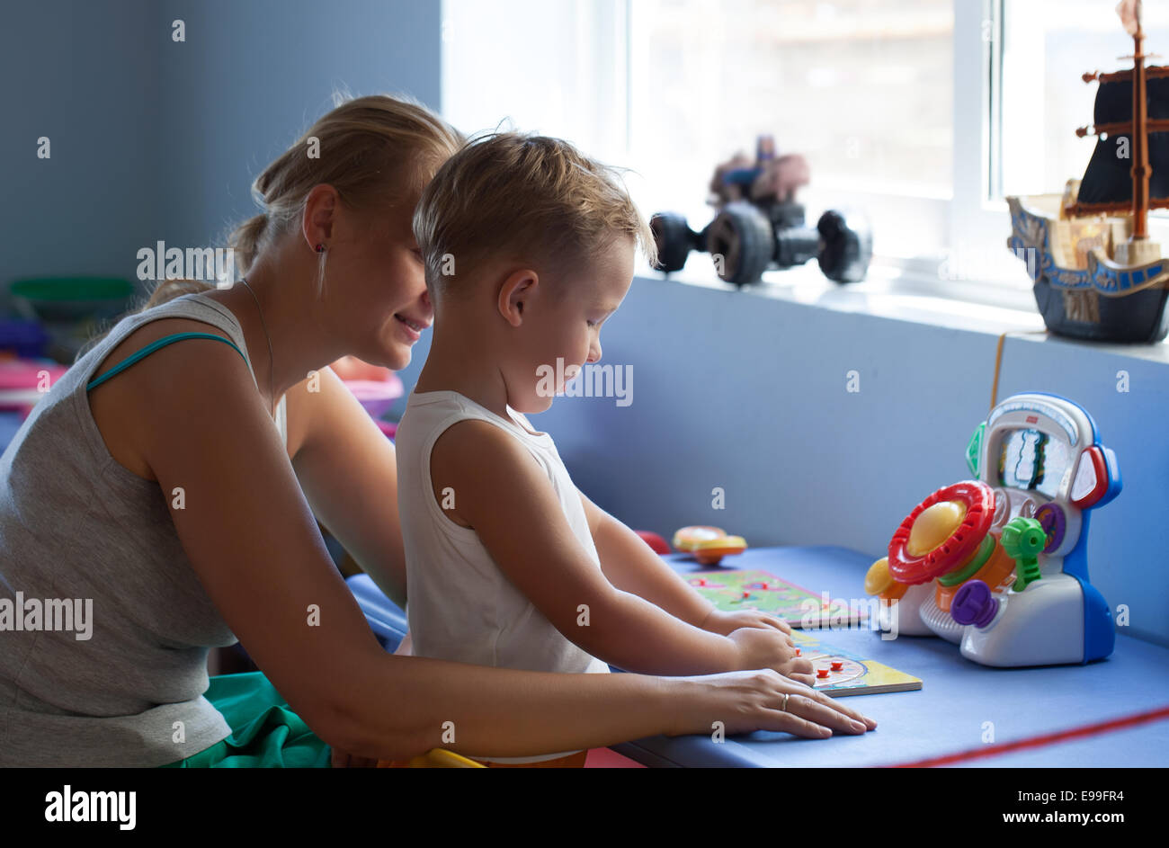 Mother playing learning game with son Stock Photo