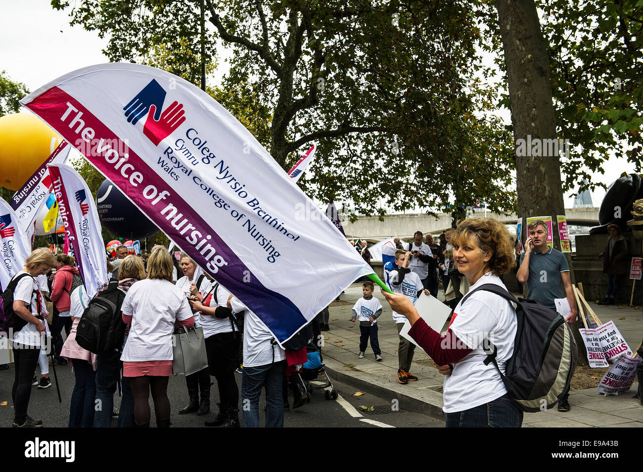 A TUC national demonstration in Central London.  A member of the Royal College of Nursing protests. - Stock Image