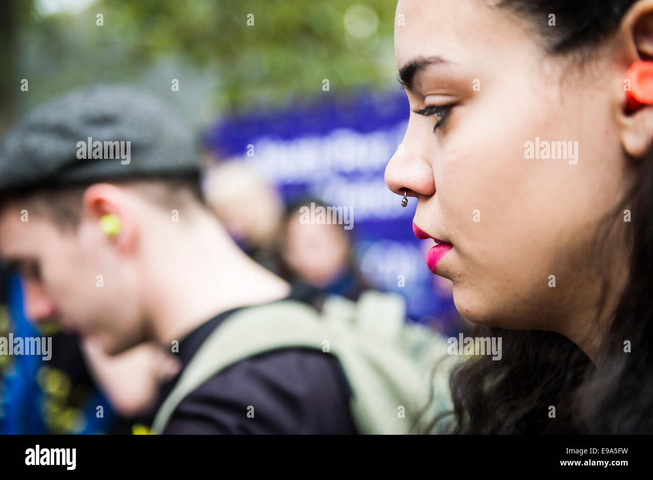 A woman with a nose piercing. - Stock Image