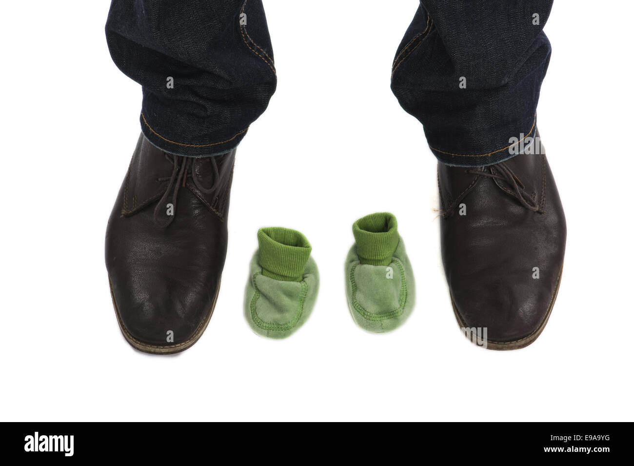 Men's Shoes and Baby Shoes - Stock Image