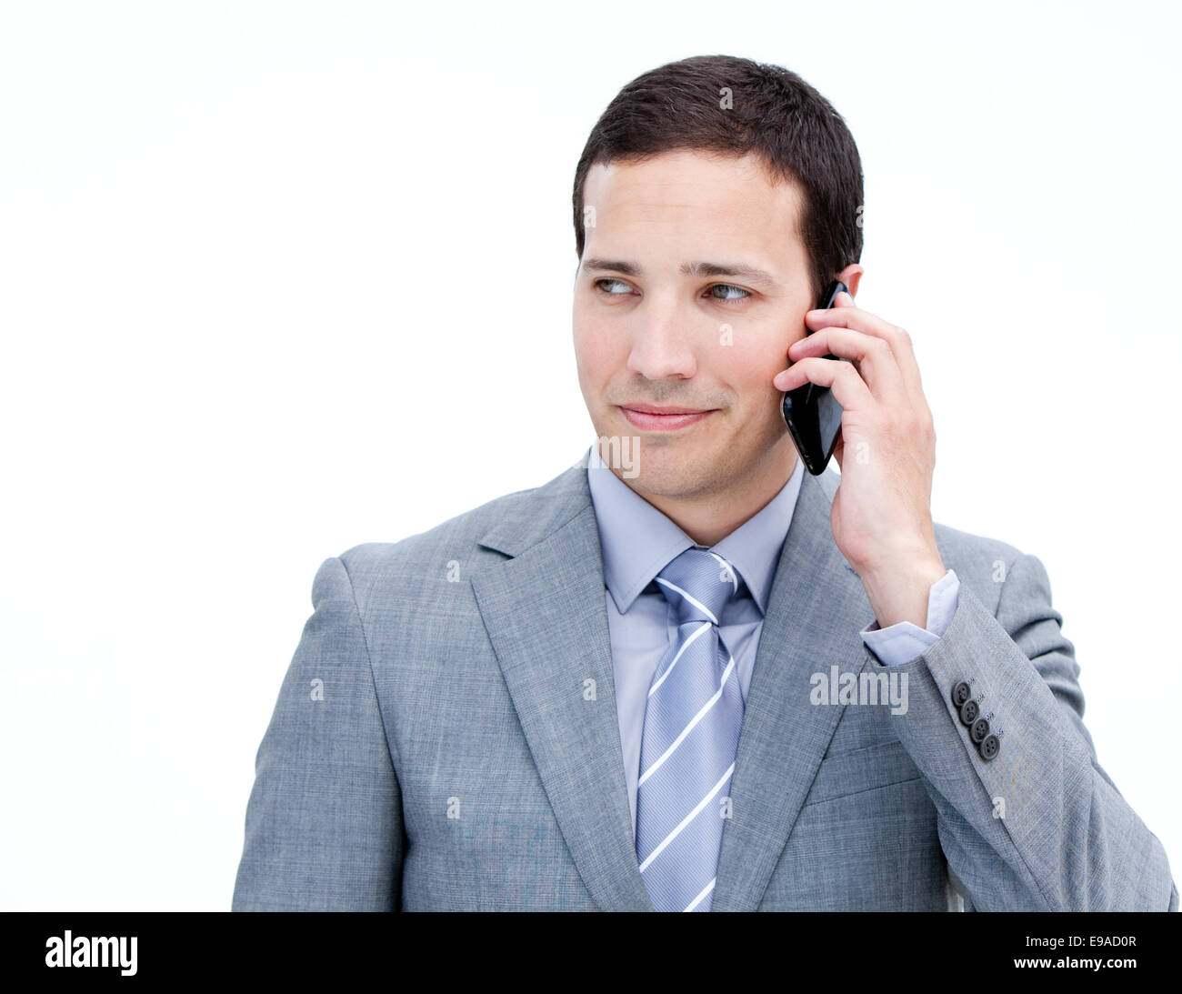 Confident businessman on phone standing - Stock Image
