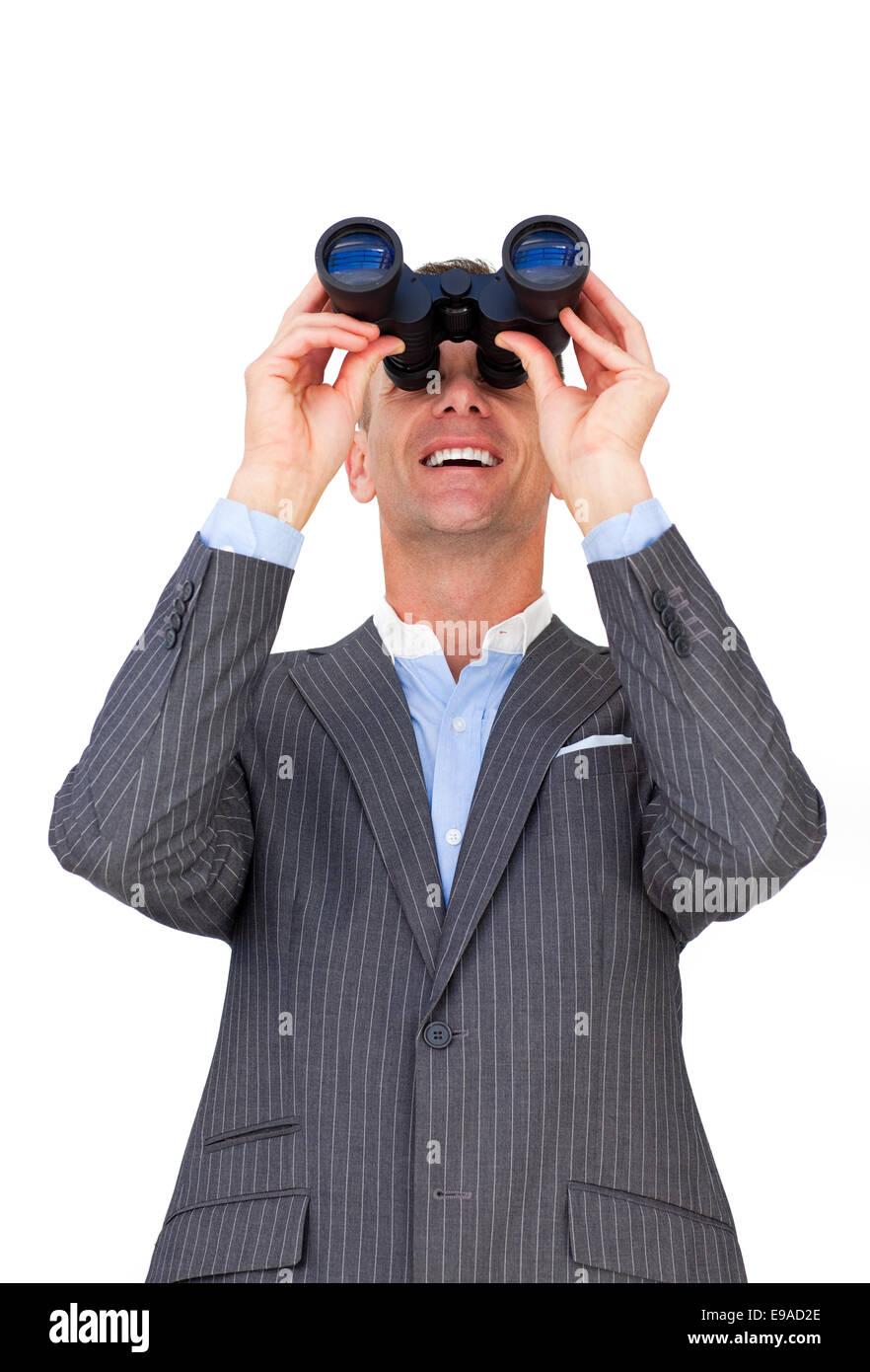 Cheerful businessman predicting future sales - Stock Image