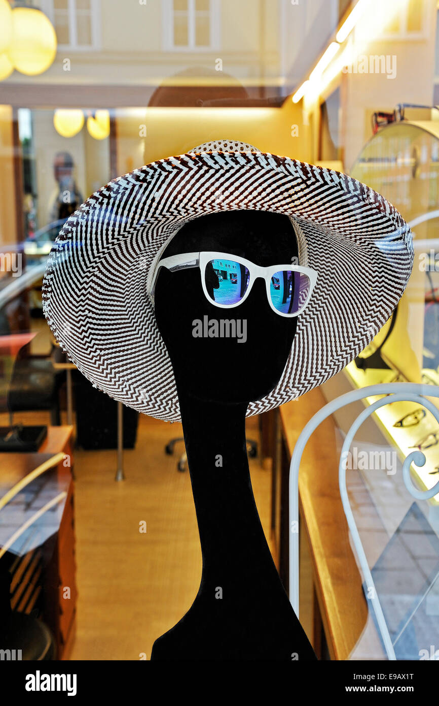 Mannequin wearing a hat and sunglasses - Stock Image