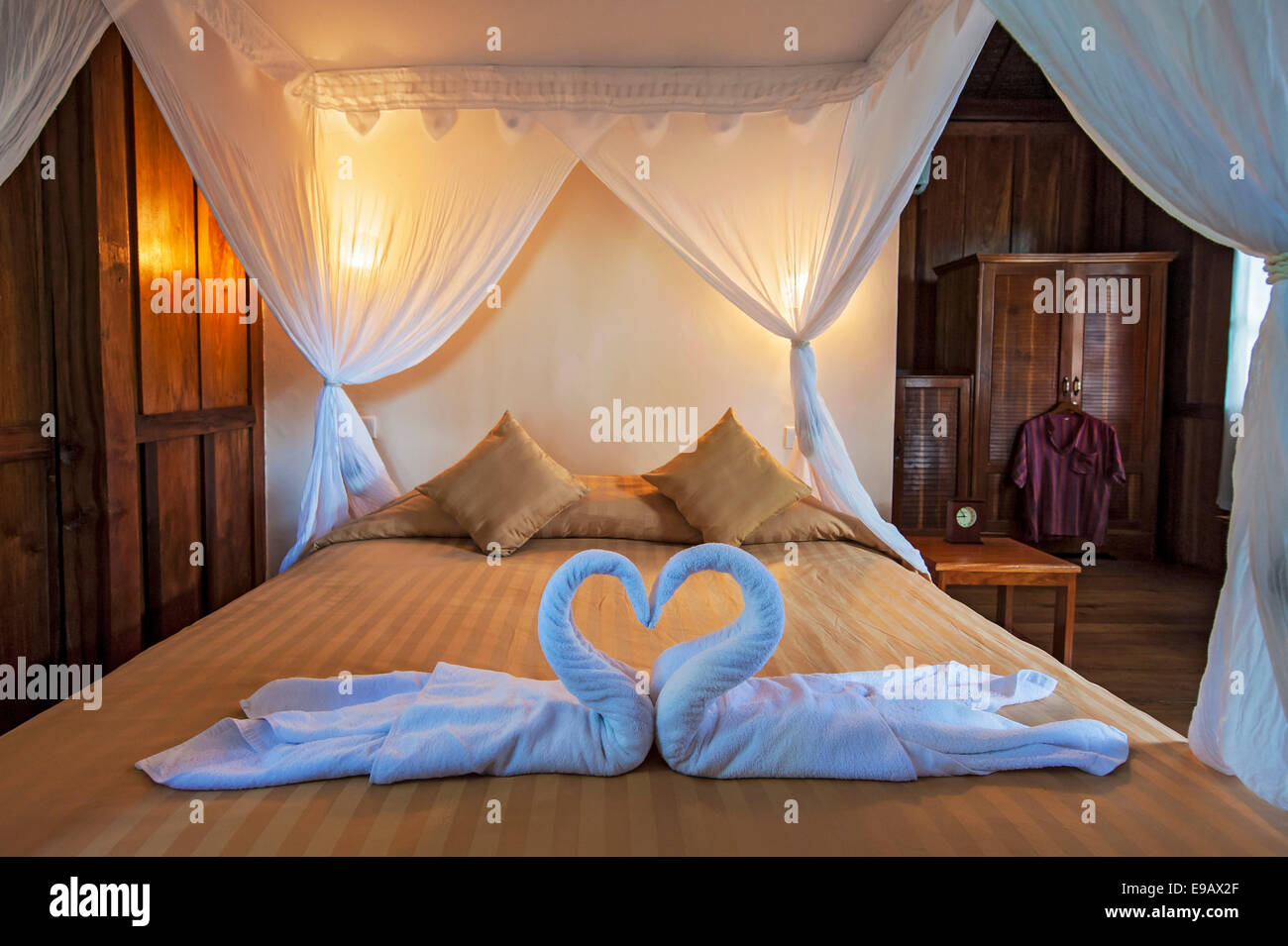 Bed in Palm Bungalow, Wakatobi Dive Resort, Sulawesi, Indonesia - Stock Image