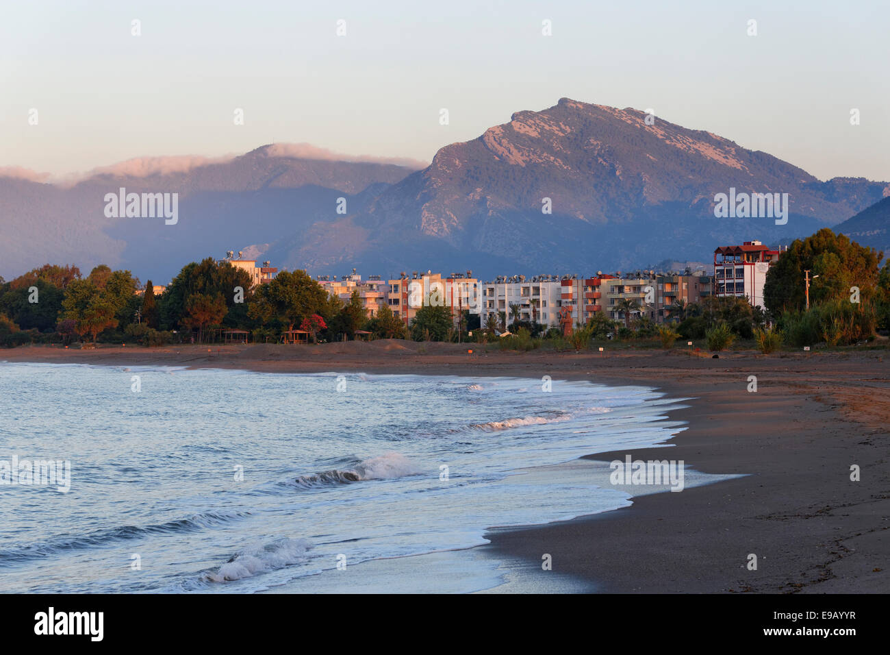 Early morning on the beach with Iskele district, Anamur, Mersin Province, Turkish Riviera, Turkey - Stock Image
