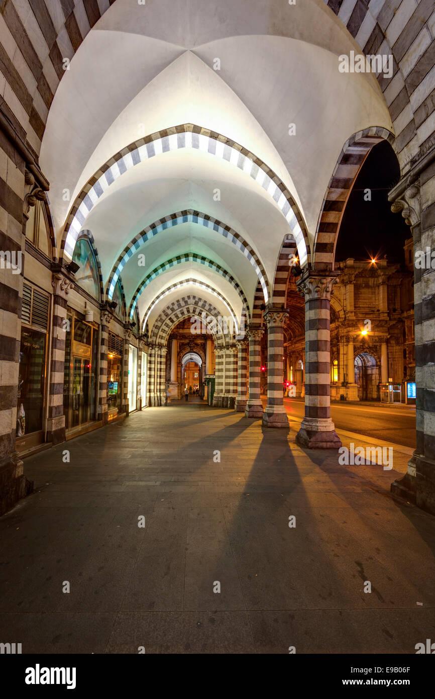 Night scene, arcades, shopping street Via XX Settembre, Genoa, Liguria, Italy - Stock Image