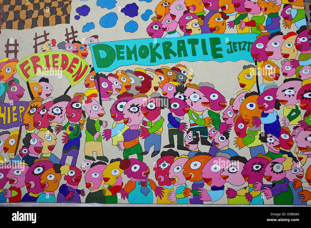 Colourful mural with the words 'Frieden' and 'Demokratie jetzt', German for 'Peace' and - Stock Image