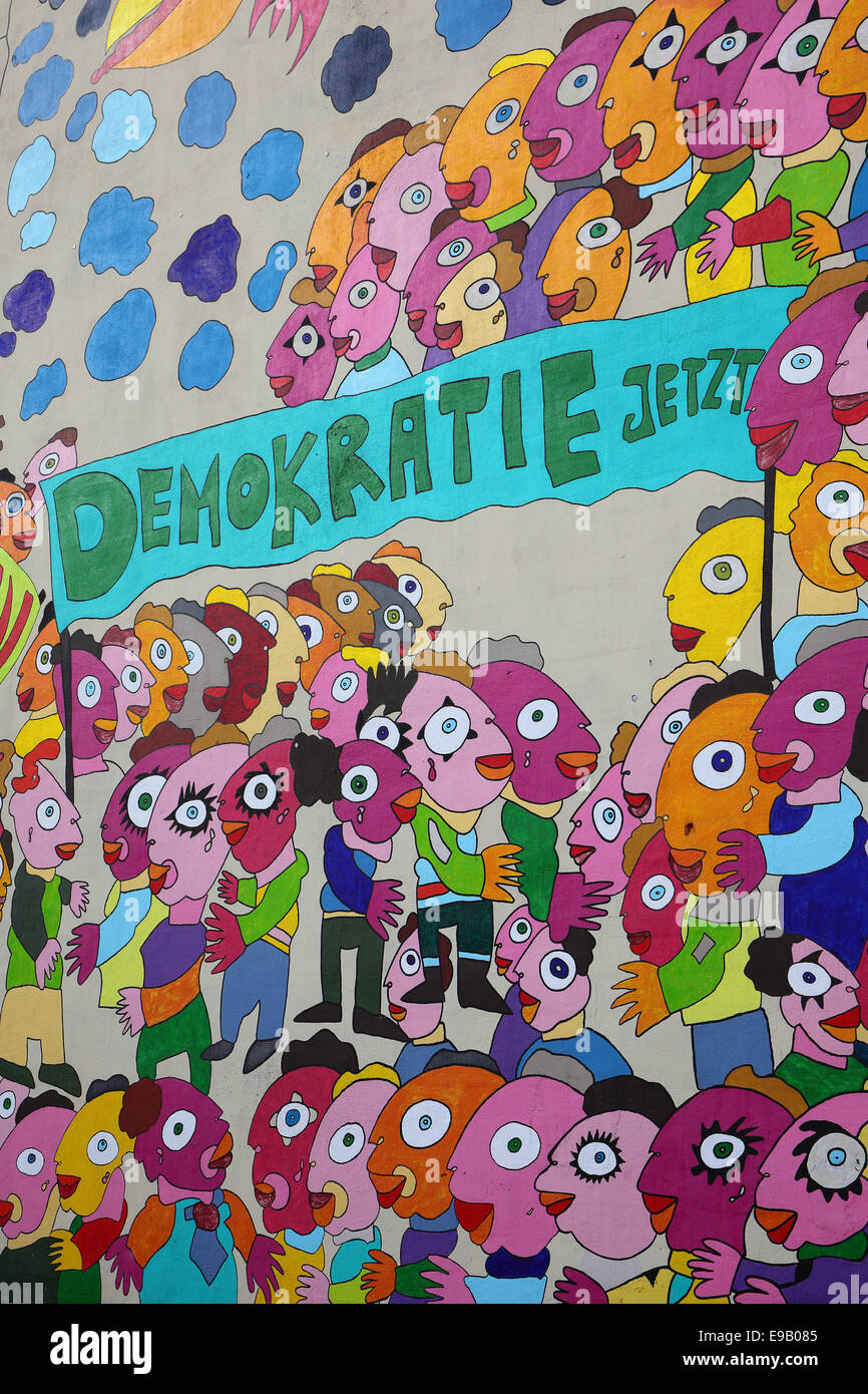Colourful mural with the words 'Demokratie jetzt', German for 'Democracy now' on a wall of the Marriott - Stock Image