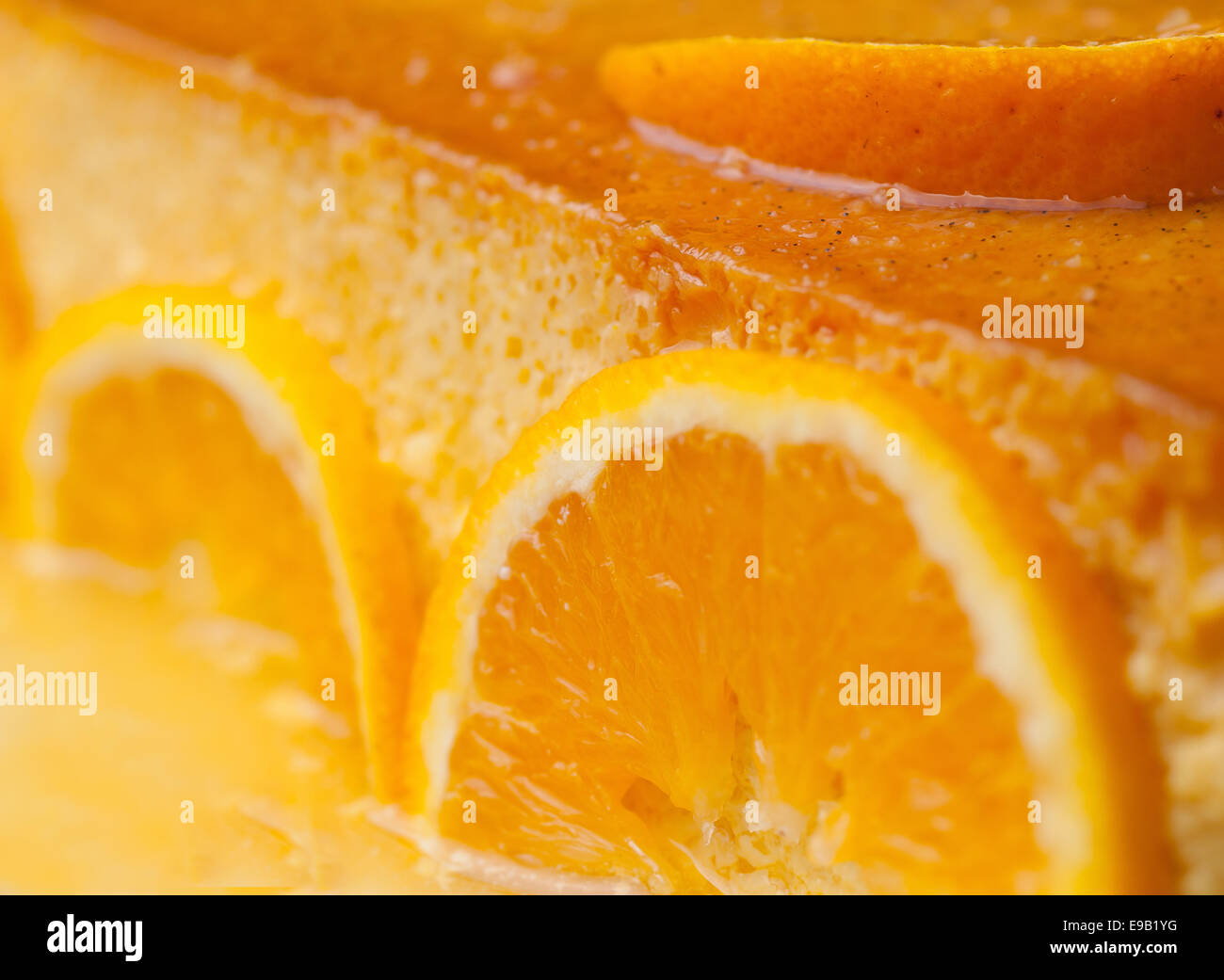 Orange custard in a studio shot. A delicious dessert. - Stock Image