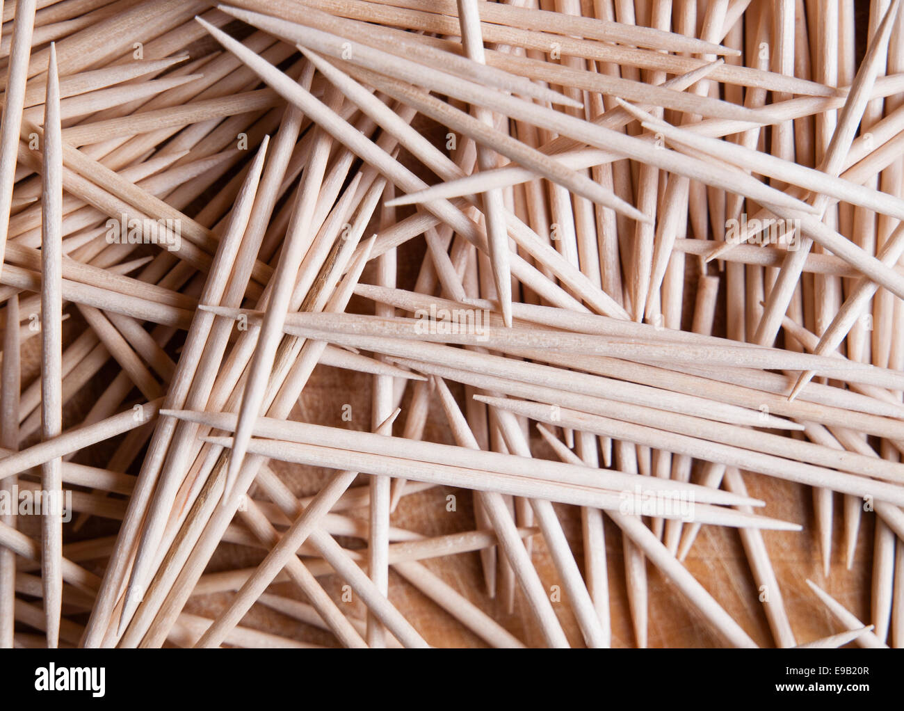 Many toothpicks in a wooden board - Stock Image