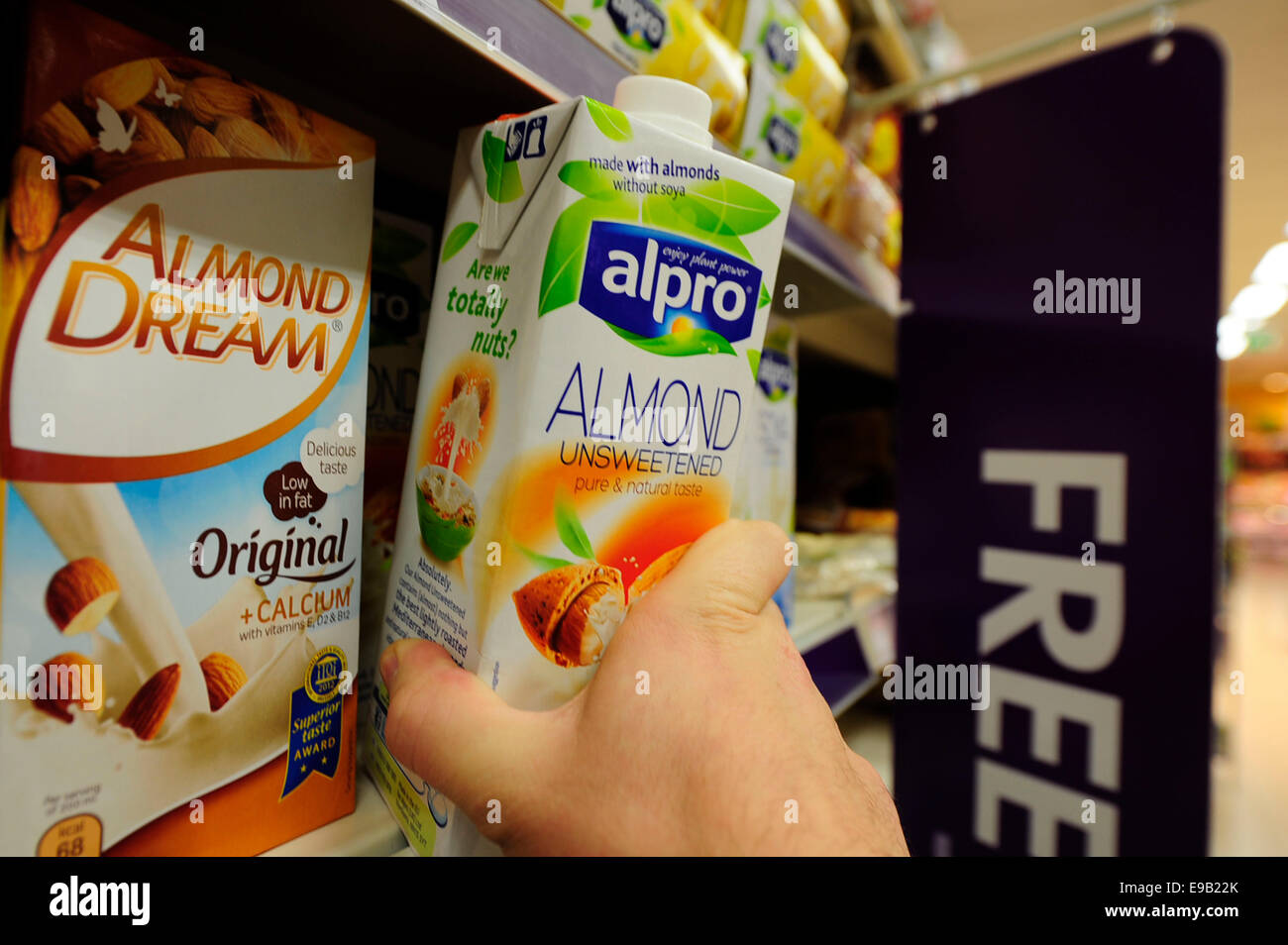 this is a alpro v product been taken from the shelf (Newscast)(Model Released) - Stock Image