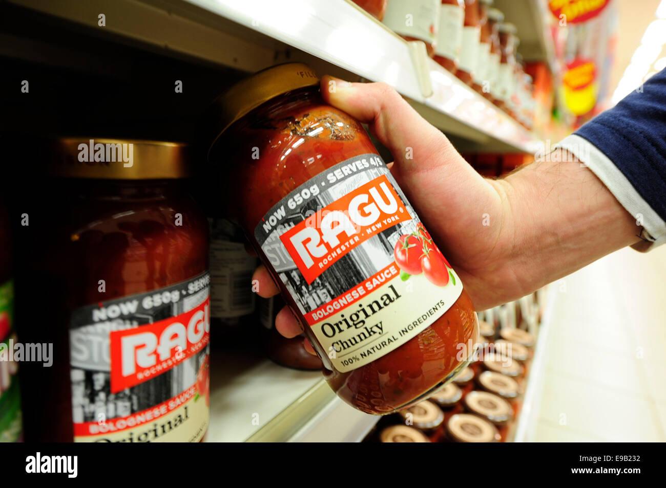 taking ragu product form shelf (Newscast)(Model Released) Stock Photo