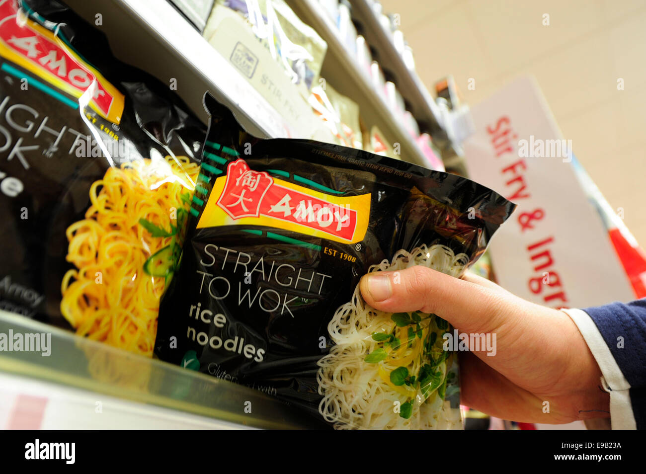 amoy product been taken from the shelf (Newscast)(Model Released) - Stock Image