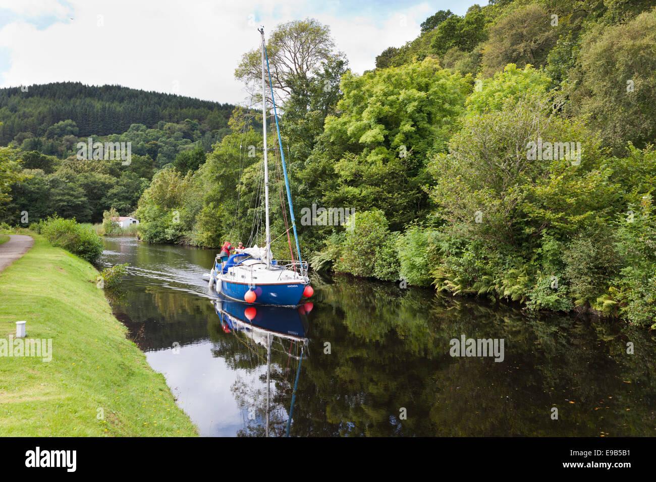 The Crinan Canal - A yacht approaching Crinan Swing Bridge, Crinan, Knapdale, Argyll & Bute, Scotland UK Stock Photo