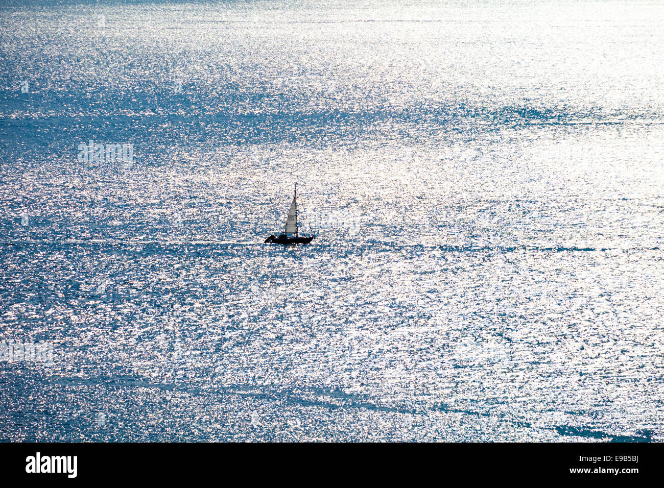 A yacht in the Sound of Jura about to enter Loch Sween, Argyll & Bute, Scotland UK - Stock Image
