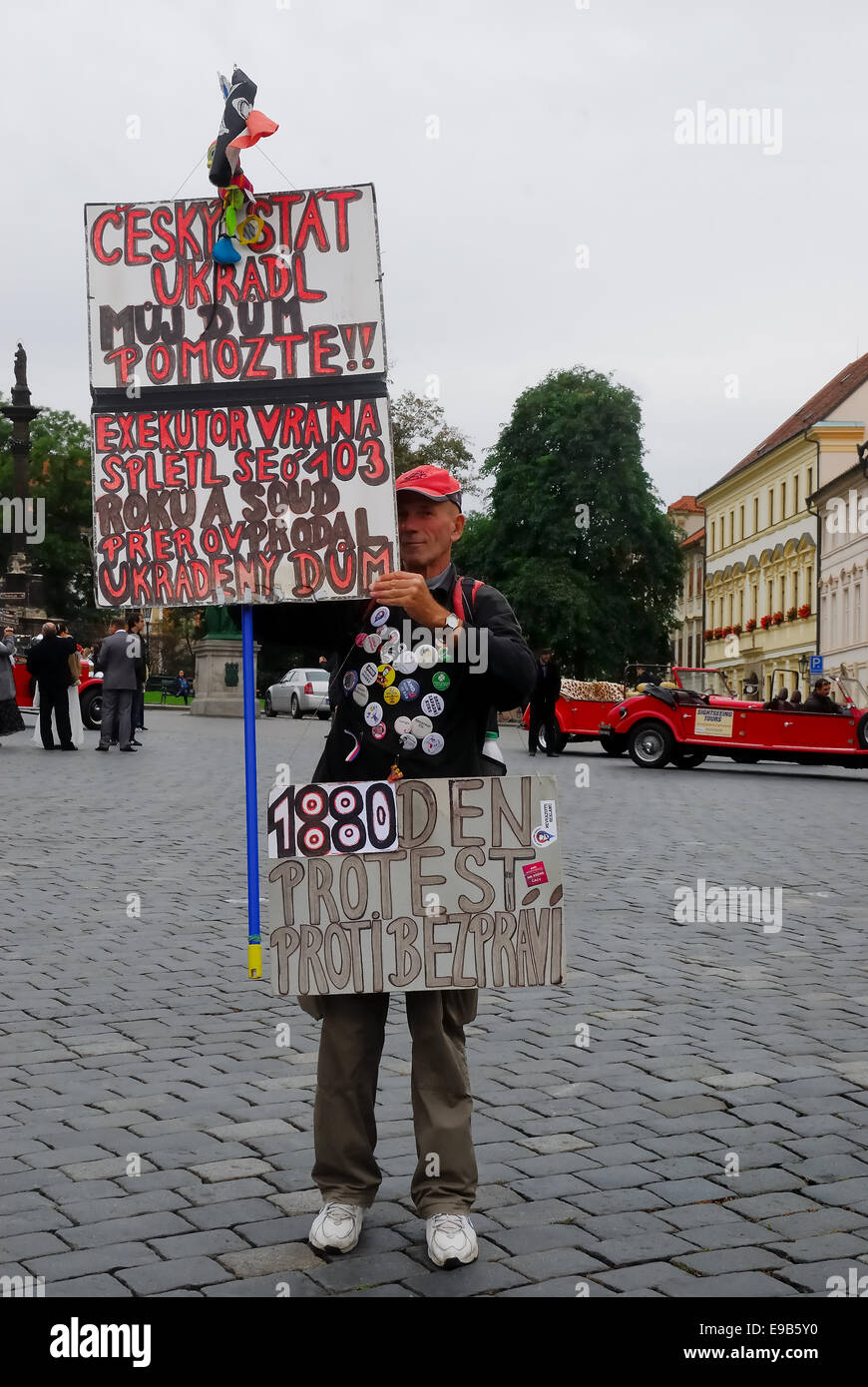 Prague, Hradcanske Namesti. A demonstrator protests from 1880 days because he confiscated the house. - Stock Image