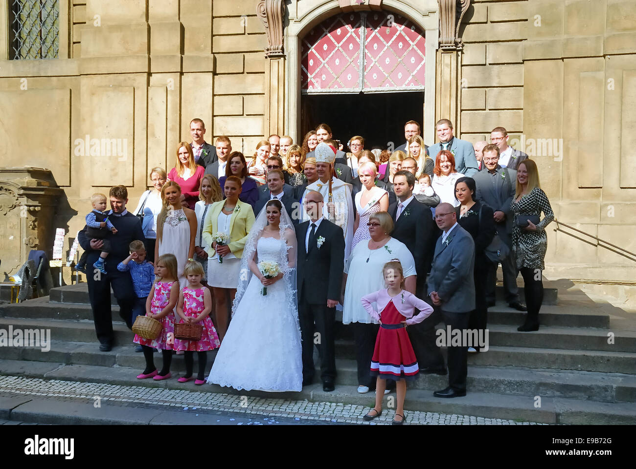 Prague, bride and groom and guests pose for a souvenir photo. - Stock Image