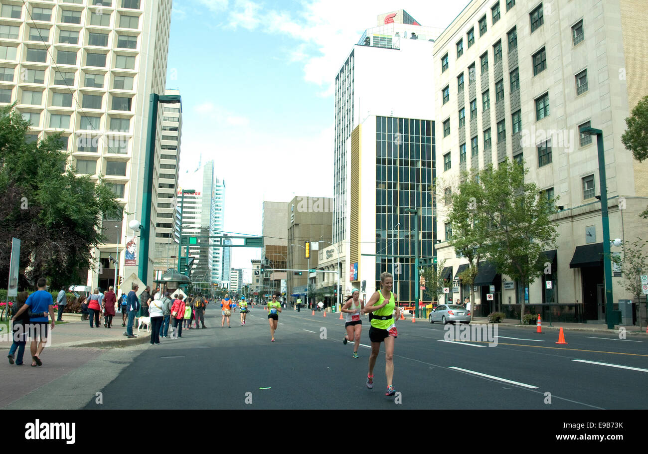 On a Sunday morning in Canada's Edmonton city a marathon is in progress; runners in Jasper Avenue approach the - Stock Image