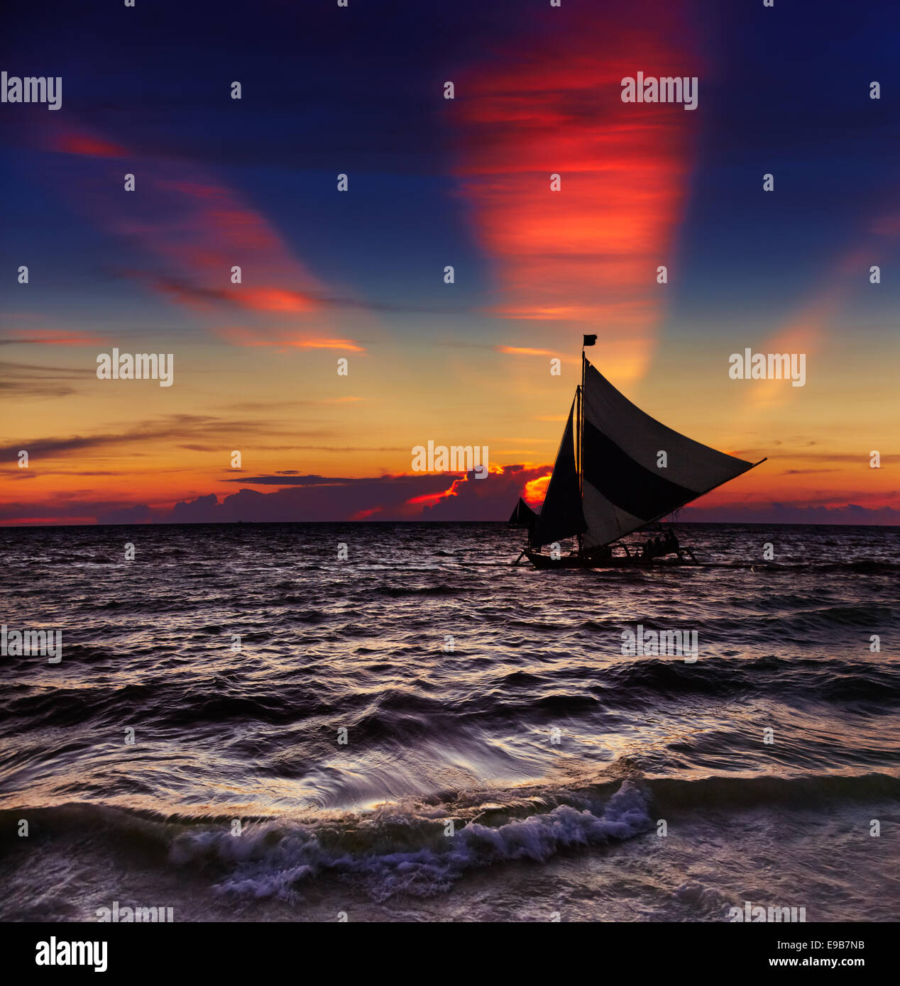 Tropical sunset with sailboat, Boracay, Philippines - Stock Image