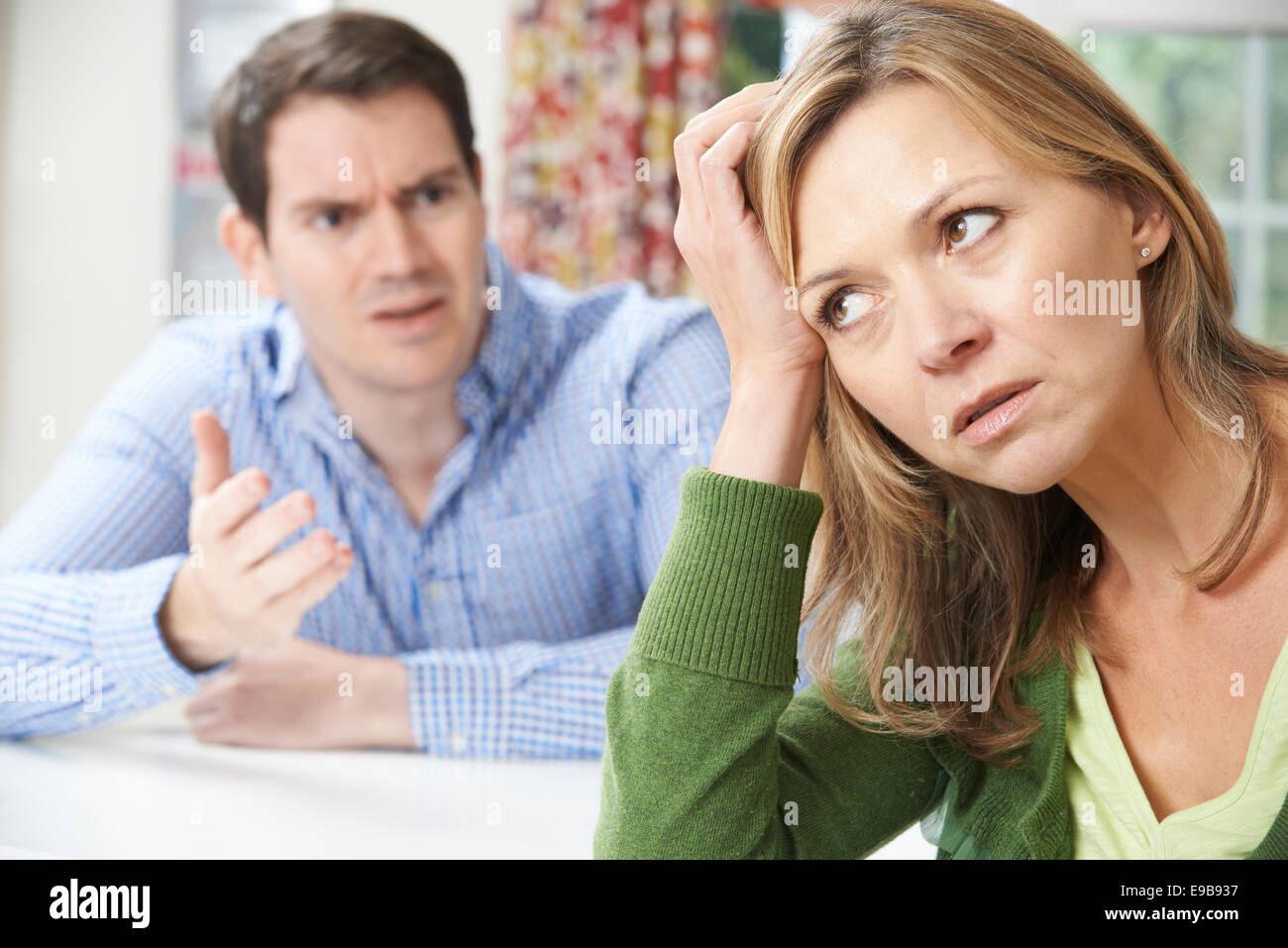 Couple Having Arguement At Home - Stock Image
