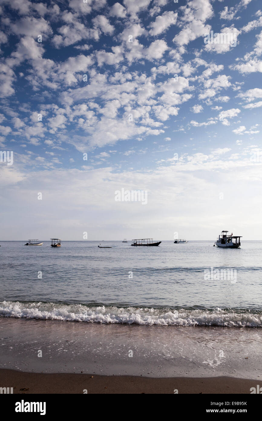 Cloudy blue sky and sea, Pemuteran beach, Bali, Indonesia - Stock Image